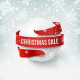 Christmas sale, snow ball with red bow and ribbon around. Stock Image