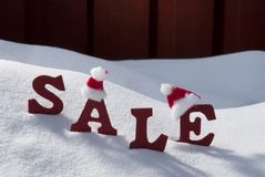 Christmas Sale On Snow With Santa Hat Stock Images