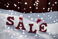 Christmas Sale Snowflakes Santa Hat On Snow Stock Photo