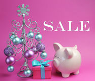 Christmas Sale still life with pastel pink and blue, with silver Christmas Tree and baubles Royalty Free Stock Photo