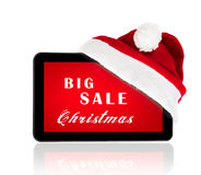 Christmas sale. Tablet with red Santa hat bow and Christmas sale on a screen stock image