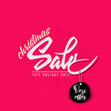 Christmas sale, tag on a shoestring Royalty Free Stock Photos