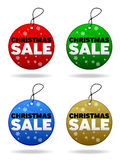 Christmas Sale Tags. A set of four Christmas Sale tags in varying colors associated with the festive season Royalty Free Stock Photo