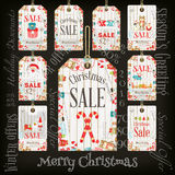 Christmas Sale Tags. On Blackboard. Chalk Text. Winter Sell-out Labels Collection. Vector Illustration royalty free illustration