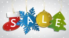 Christmas sale tags on a snowy background Royalty Free Stock Images