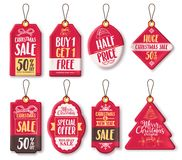 Christmas sale tags vector set with different shapes and discount text and greeting Stock Photos