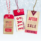 After Christmas sale tags. On winter nackground with snowflakes. EPS 10 vector illustration Royalty Free Stock Images