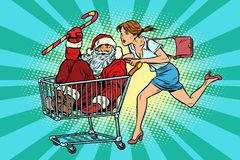 Free Christmas Sale. The Woman Bought Santa Claus. Shopping Cart Trol Stock Photos - 124480653