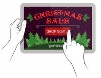 Christmas sale on touchpad screen. Hands holding touchpad with Christmas Sale on gadget screen Royalty Free Stock Photos