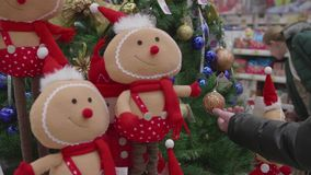 Christmas sale of toys and Christmas trees until Christmas. People in the supermarket are shopping before the new year. Christmas gifts for loved ones. Christmas stock video footage