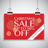 Christmas Sale up to 50% on Red Back. Poster hanging on clamps i Royalty Free Stock Images