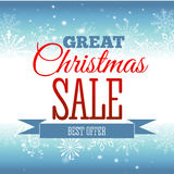 Christmas sale. Vector background with snowflakes and shining sparks. Badge. Inscription. Stock Photo