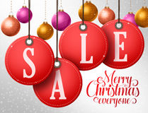 Christmas sale vector design in hanging red sale tags with colorful christmas balls vector illustration