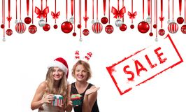 Christmas sale. Holiday. Beautiful girls in santa hat royalty free stock photo