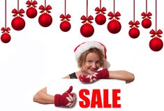 Christmas sale. Holiday. Beautiful woman in santa hat royalty free stock images