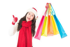 Christmas sale woman happy shopping thumbs up for goods Stock Photo