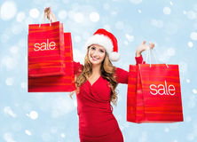 Christmas SALE - woman holding a red sale bags Royalty Free Stock Photos