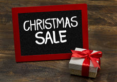Christmas sale wooden frame chalkboard with gift pack Royalty Free Stock Photos