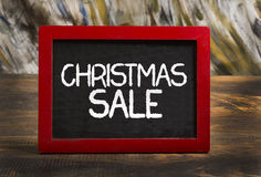 Christmas sale wooden frame chalkboard on table Stock Images