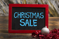 Christmas sale wooden frame chalkboard on table with ball and rings Royalty Free Stock Photography