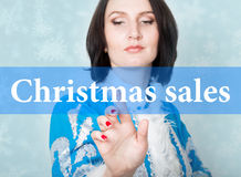 Christmas sale written on virtual screen. concept of celebratory technology in internet and networking. woman in Royalty Free Stock Image