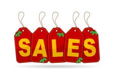 Christmas sales. Promotional red tags for Christmas sales over white Royalty Free Stock Image