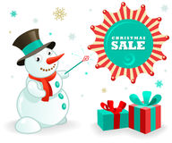 Christmas Sales Banner: Funny Snowman and xmas gifts Stock Photo