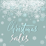 Christmas sales grunge lettering design on blue background with white snow. Holiday lettering card. Vector illustration. Snowflakes background. EPS 10 Stock Photography