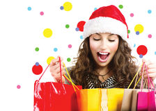 Christmas sales. Surprised woman royalty free stock images