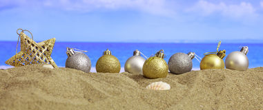 Christmas on a sandy beach Royalty Free Stock Image