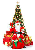 Christmas Santa. Smiling Santa and Christmas Tree. Over white background Royalty Free Stock Images