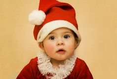 Christmas Santa Baby. Portrait of a baby in santa clothing Stock Photography