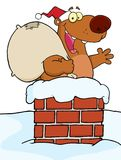 Christmas santa bear in a chimney Stock Photography