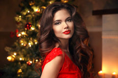 Christmas Santa. Beautiful smiling woman model. Makeup. Healthy Royalty Free Stock Images