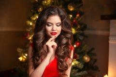 Christmas Santa. Beautiful smiling woman model. Makeup. Healthy Royalty Free Stock Photography