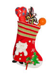Christmas santa boots full of gifts for puppy dog. Christmas Santa stocking full of gifts for dog royalty free stock photo
