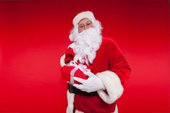 Christmas. santa claus with big bag on shoulder is on red background.  Stock Image