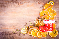 Christmas, Santa Claus boots and Slices of dried orange, spices Stock Photography