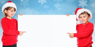 Christmas Santa Claus children kids snow pointing looking empty stock image