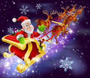 Christmas Santa Claus flying sleigh with gifts. Christmas illustration of Santa Claus flying in his sled or sleigh with night background Royalty Free Stock Image