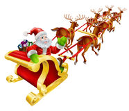 Christmas Santa Claus flying in sleigh. Christmas illustration of Cartoon Santa Claus flying in his sled or sleigh and waving Royalty Free Stock Image