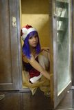 Christmas Santa Claus girl looks out of a case Stock Image