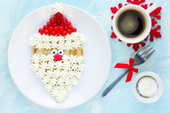 Christmas Santa Claus pancake with whipped cream and berry , Chr Royalty Free Stock Image