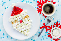 Christmas Santa Claus pancake with whipped cream and berry , Chr Stock Image