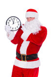 Christmas Santa Claus pointing at clock showing five minutes to midnight. Isolated on white background. Happy New Year concept stock image