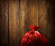 Christmas Santa Claus Red Bag Full, Xmas Wood, Wooden Plank Wall Royalty Free Stock Images