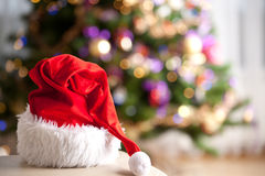 Christmas. Santa Claus red hat in front of a christmas tree. Christmas background Stock Image