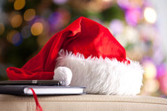 Christmas. Santa Claus red hat in front of a christmas tree. Christmas background Royalty Free Stock Photo