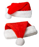 Christmas Santa Claus red hats on white Royalty Free Stock Images