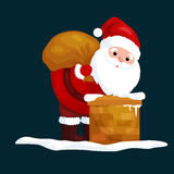 Christmas Santa Claus in red suit with bag full of gifts in the chimney climbs that would give presents on Christmas Eve Royalty Free Stock Photos